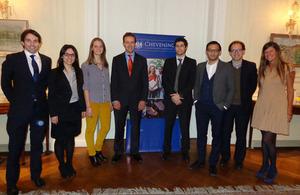 The nine new scholars with Chargé d'Affaires Richard Barlow