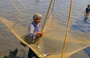 Fisherwoman with lift net in a community fishery in Lao PDR
