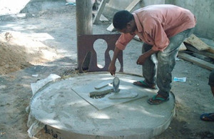 Latrine builder in Dar es Salaam learning to build slabs