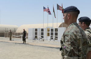 Service personnel at a flag ceremony at Camp Bastion to mark the relocation of Task Force Helmand  [Picture: Sergeant Barry Pope, Crown copyright]