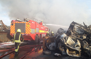 Firefighters tackle a blaze at a vehicle scrapyard and metal recycling facility in Royal Wootton Bassett