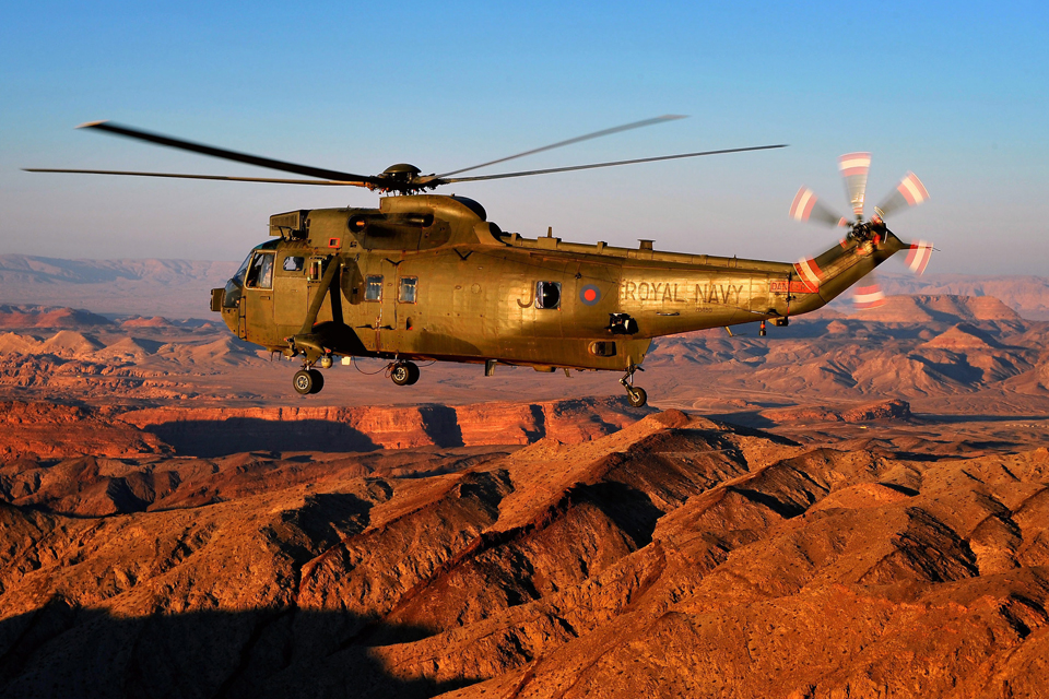 A Sea King helicopter flies over the Jordanian desert
