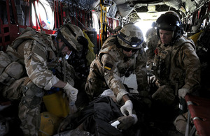 A Medical Emergency Response Team treats a casualty on board an RAF Chinook helicopter in Afghanistan
