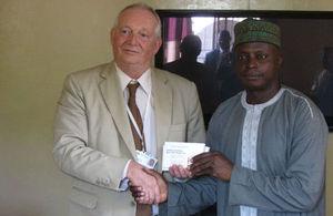 British High Commissioner David Morley handing over drug testing kits to the NDEA