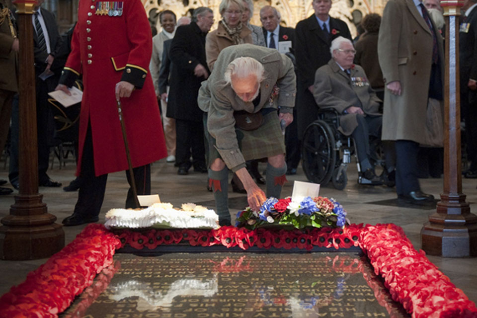 Major Peter Watson MC, a former Black Watch officer, pays his respects at the Grave of the Unknown Warrior