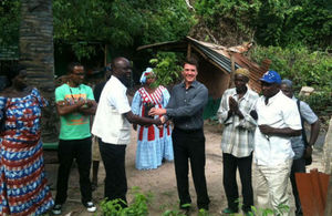 Deputy High Commissioner George Sherriff donating tree saplings to Bijilo Forest Park