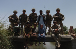 British and Afghan Service personnel with local villagers on the new bridge