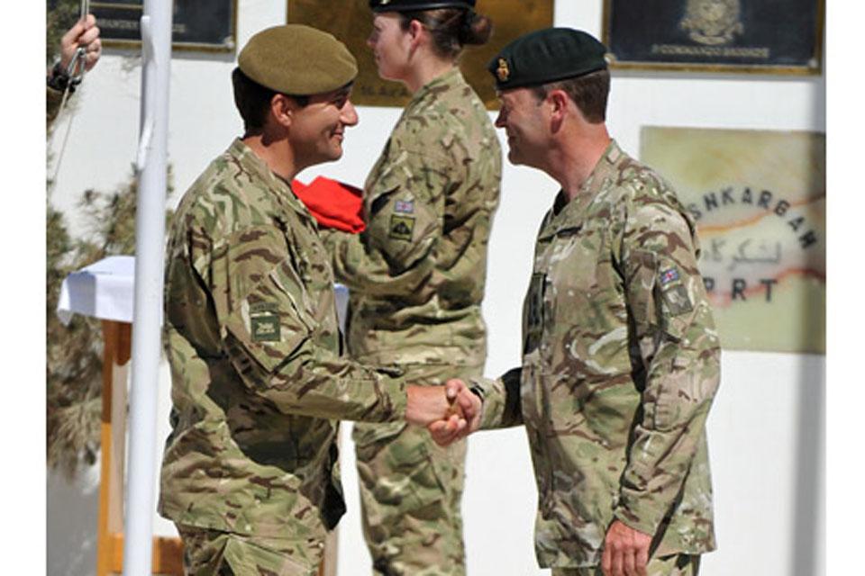 Brigadier Doug Chalmers, Commander of 12 Mechanized Brigade (left), takes over command of Task Force Helmand from Brigadier Patrick Sanders, Commander of 20th Armoured Brigade