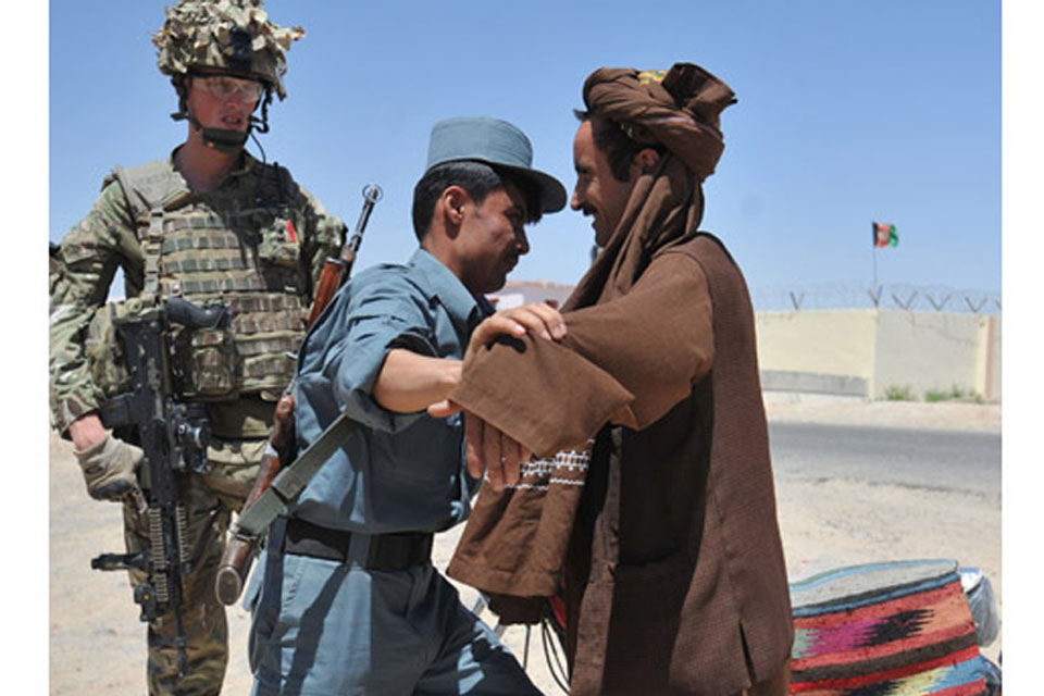 Lance Corporal Cooper working with the Afghan Uniform Police in Lashkar Gah