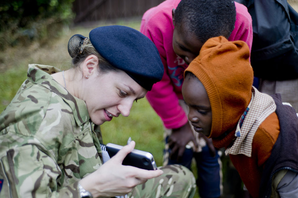 Captain Martha Fairlie of the Military Stabilisation Support Group chats with local children in Kenya