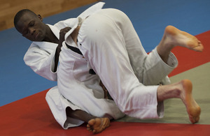 Trooper Emmanuel Nartey holds down an opponent during a judo training session