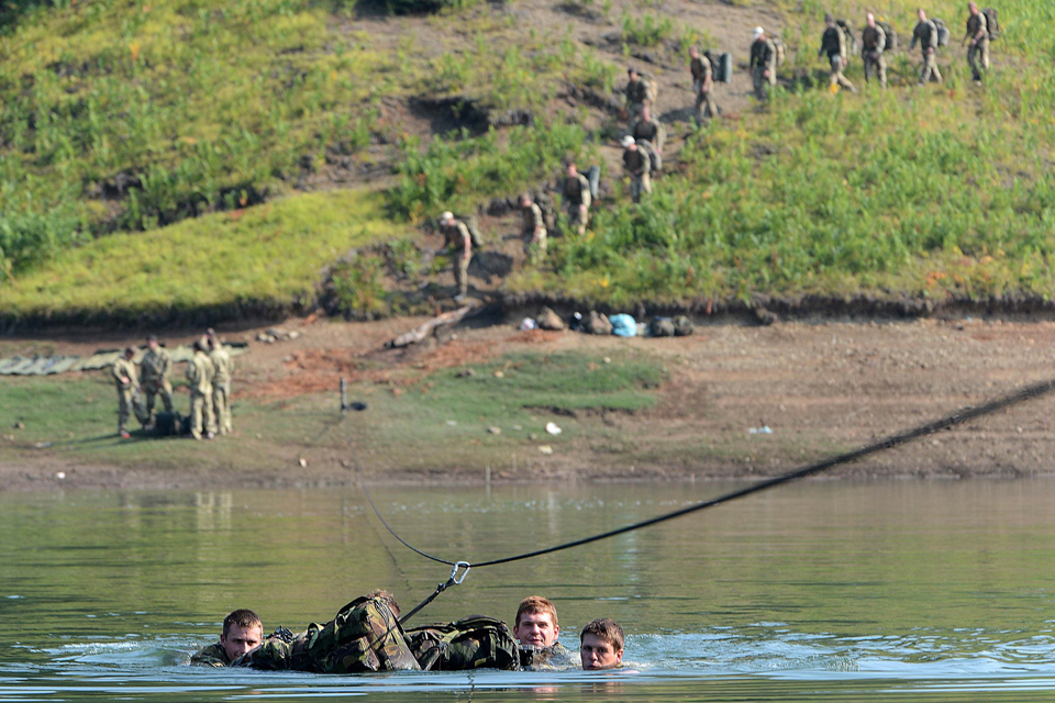 Royal Marines from 42 Commando taking part in a river crossing