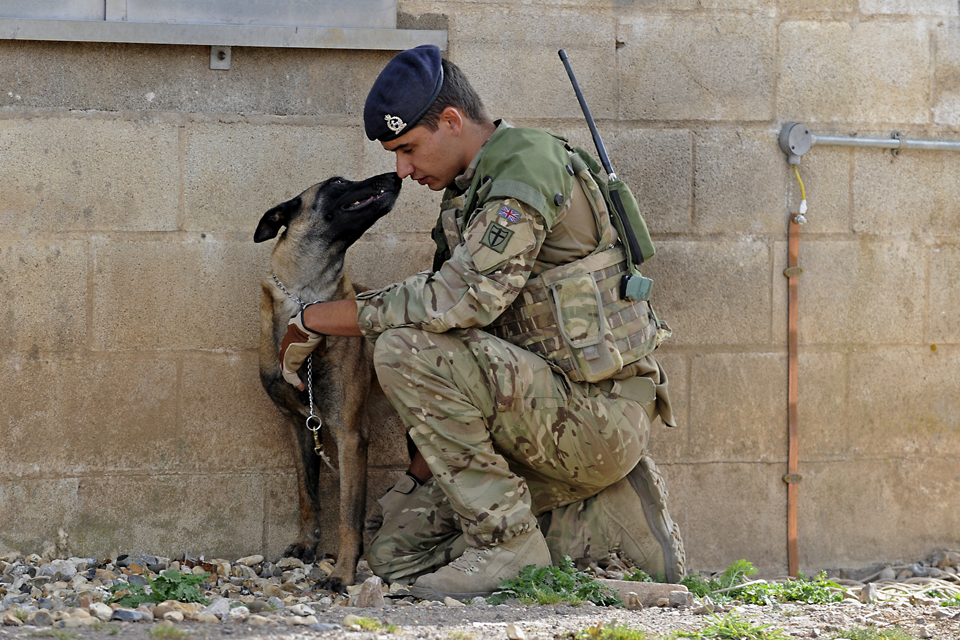 Private Danny Greenhalgh with military working dog Amy