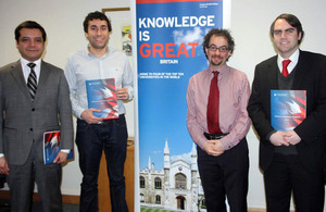 Ambassador Jon Benjamin with three of the departing scholars.