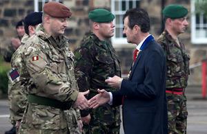 Councillor Carl Crompton presents medals to soldiers of 42 (North West) Brigade in Preston