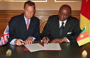 Foreign Office Minister Mark Simmonds with Pierre Moukoko Mbonjo, Cameroon Minister for External Relations in London.