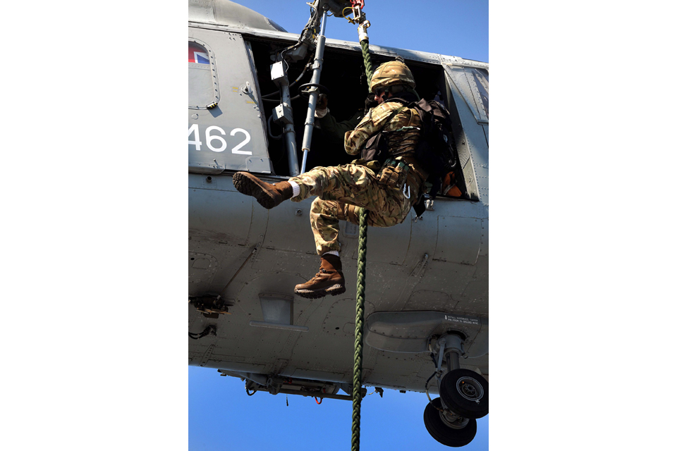 A Royal Marine fast ropes from a Lynx helicopter