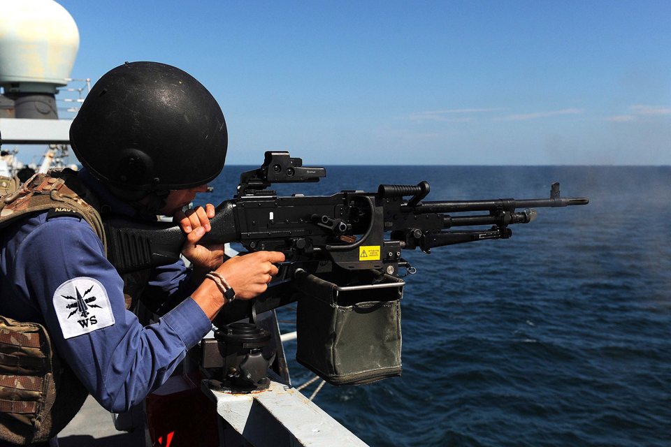 A member of HMS Westminster's gunnery team