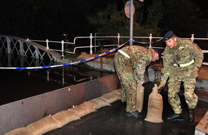 Soldiers from 2nd Signal Regiment assist the flood relief effort in North Yorkshire in the early hours of Thursday 27 September