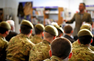 Bestselling author Andy McNab addressing young soldiers on the benefits of education in the Catterick Garrison library
