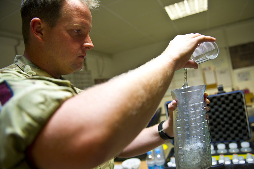Flight Sergeant Dan Biggs conducts bacteriological water testing