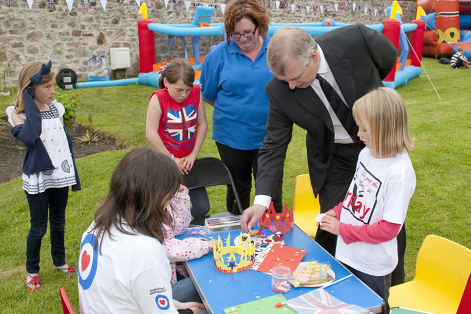 His Royal Highness Prince Andrew joins children in decorating crowns at the RAF Lossiemouth Children's Jubilee Garden Party