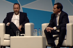 Chancellor and Jimmy Wales on stage at Campus Party