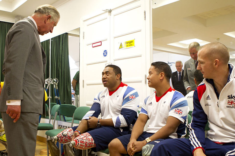 His Royal Highness The Prince of Wales talking to Paralympians Private Derek Derenalagi and Lance Corporal Netra Rana in the new Jubilee Rehabilitation Complex at Headley Court