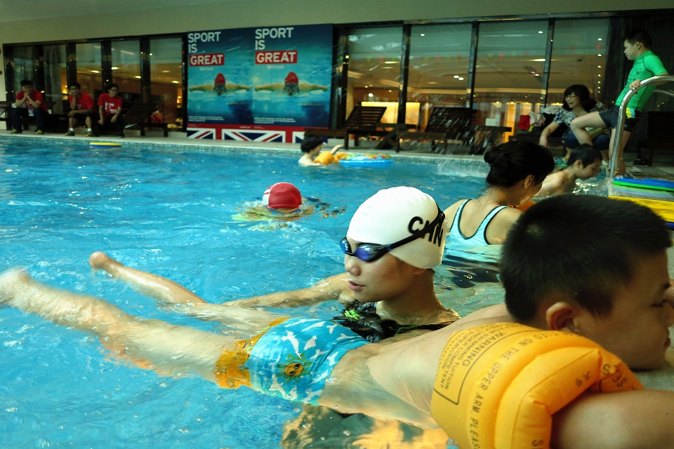 Ms Lin Ping, 2012 Paralympic swimming gold medalist coaching special needs children how to swim at the anniversary event.