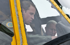 His Royal Highness The Duke of Cambridge, Flight Lieutenant William Wales, shows his father, His Royal Highness The Prince of Wales, his 'office' - the cockpit of an RAF Sea King Search and Rescue helicopter