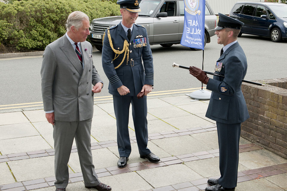 His Royal Highness The Prince of Wales is welcomed to RAF Valley by Group Captain Adrian Hill, the Station Commander, and Warrant Officer Dave Hegarty, the Station Warrant Officer