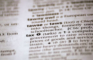 The word tax in a dictionary