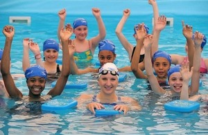Rebecca Adlington in swimming pool with young people at a Pools 4 Schools event