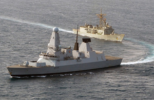 Royal Navy Type 45 destroyer HMS Diamond, in the foreground, exercises with the Royal Australian Navy Adelaide Class guided missile frigate HMAS Melbourne