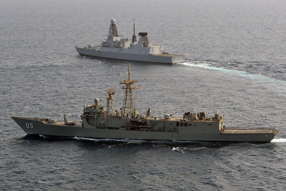 HMAS Melbourne, in the foreground, exercises with HMS Diamond