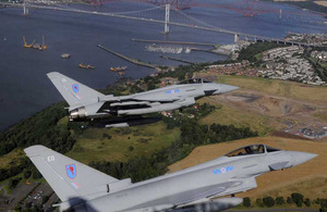 Two Typhoon aircraft from 6 Squadron based at RAF Leuchars fly in a close formation over the Forth Rail and Forth Road Bridges in Edinburgh to mark the stand-up of No 1 (Fighter) Squadron