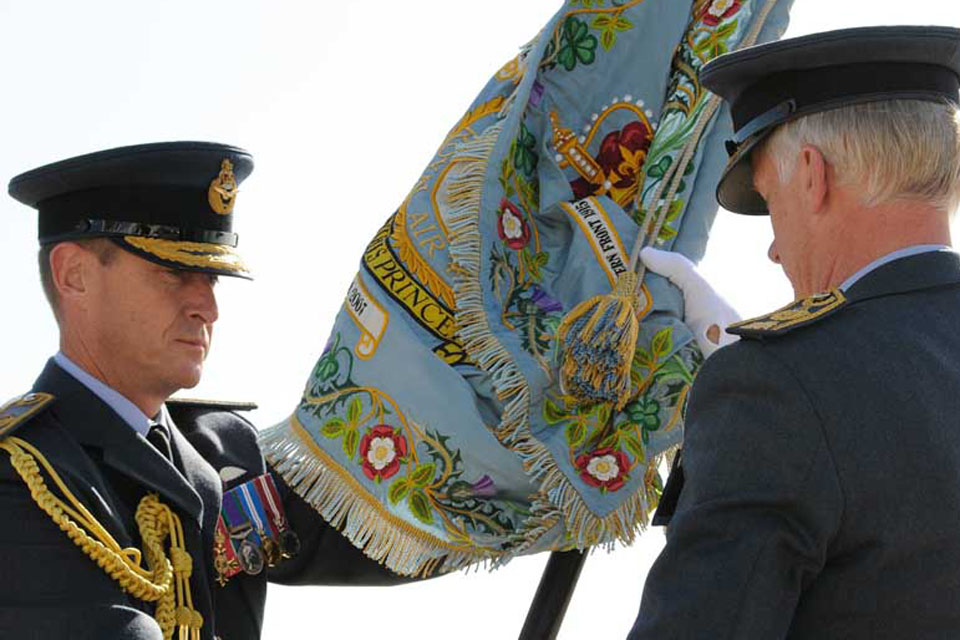 Air Officer Scotland, Air Commodore Gavin Parker, hands the 1 (Fighter) Squadron standard to Air Chief Marshal Sir Stephen Dalton