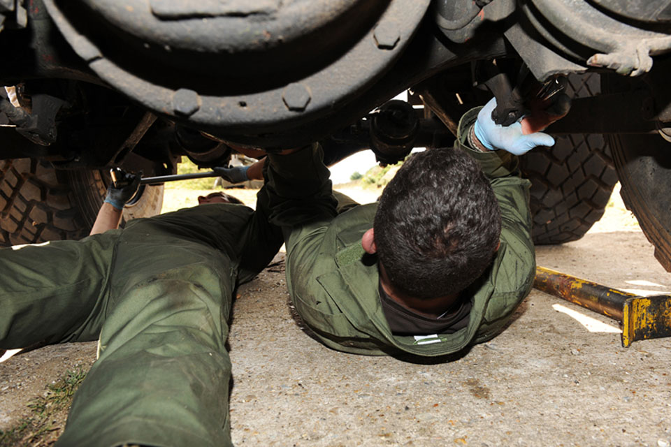 Vehicle mechanics of 7 Air Assault Battalion Royal Electrical and Mechanical Engineers at work during Exercise Active Chariot