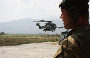 """Albanian Lion 13"" - a Royal Marines Commando and a RAF Mk3 Merlin helicopter in Kuçova."