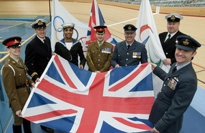 Tri-Service military personnel hold out a Union Flag to promote the Armed Forces' role in the London 2012 Olympic and Paralympic Games which took place this summer