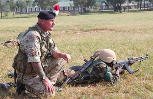 Corporal Matthews positioning a Ugandan soldier to provide all-round defence [Picture: Crown copyright]