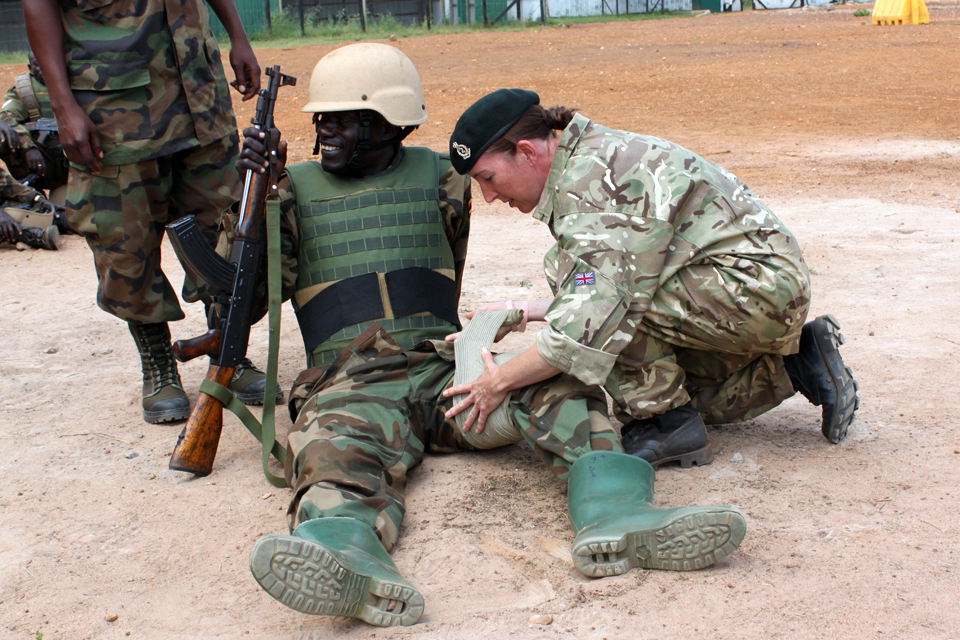Corporal Bebbington bandages a leg during a training exercise