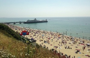 Bournemouth beach fills up on hottest day of year in July 2013