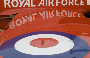 The wing and roundel of an RAF Red Arrows Hawk jet aircraft