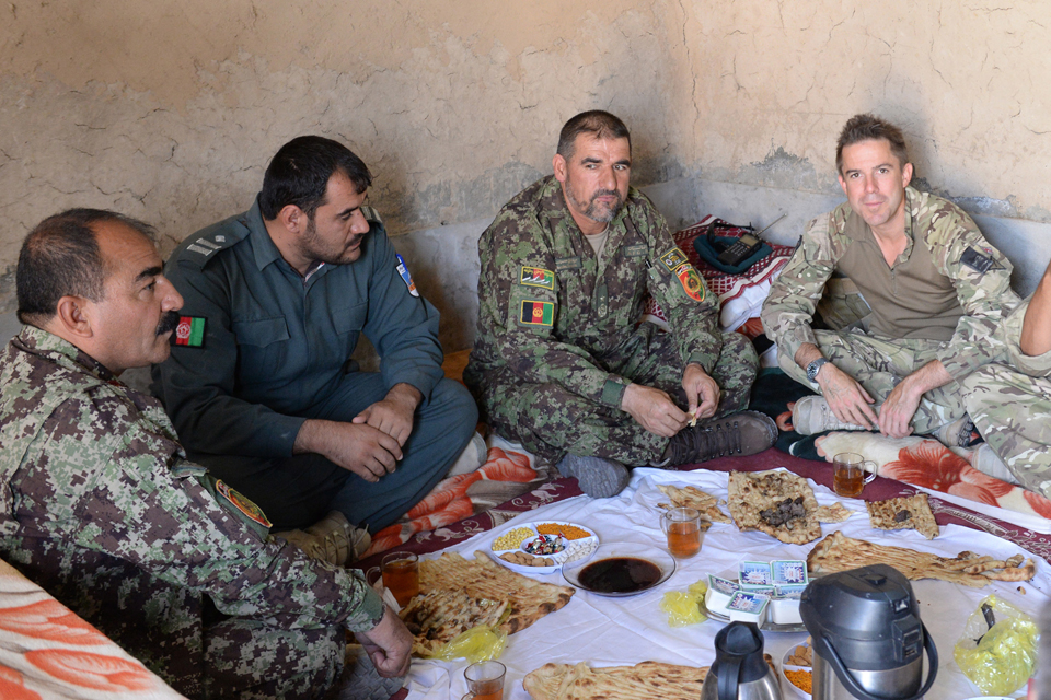Afghan and British officers dine together