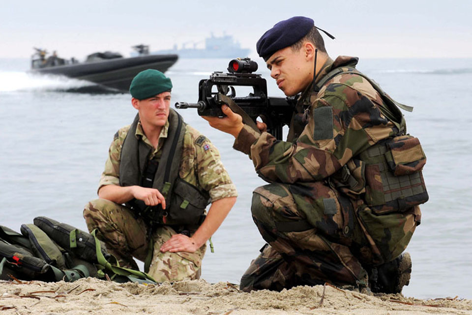 A Royal Marine and a French Marine ready for action after being inserted onto a beach during Exercise Corsican Lion