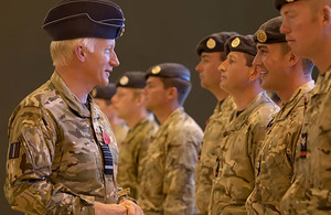 Air Chief Marshal Sir Stephen Dalton chats with RAF police personnel on their return from Afghanistan