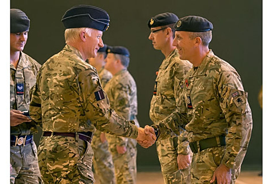 Air Chief Marshal Sir Stephen Dalton shakes hands with a member of the RAF Police
