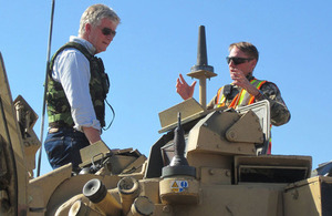 High Commissioner Howard Drake gets an up close look at a Warrior Infantry Fighting Vehicle.