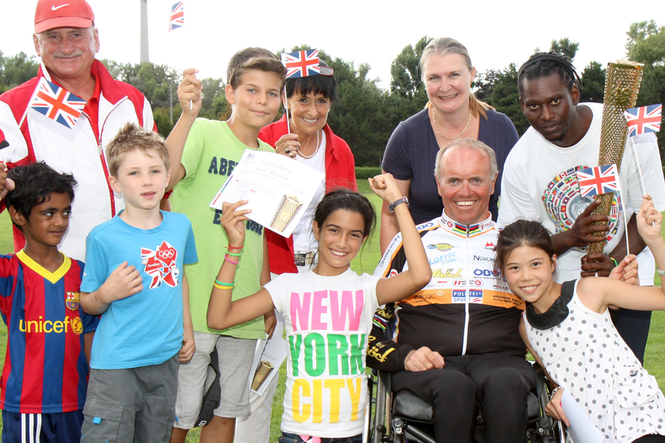 HMA Susan le Jeune d'Allegeershecque and the Austrian paralympic medal winner, Wolfgang Schattauer, at the VIC Summer Camp sports day